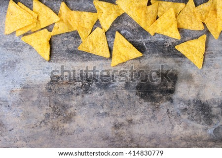 Food background. Mexican nachos chips over old textured tin background. Top view. With copy space  - stock photo