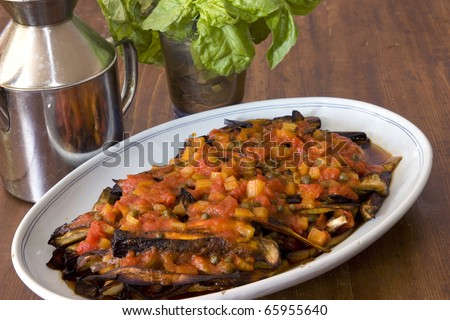Food background of eggplant and pepper stew from italian cuisine
