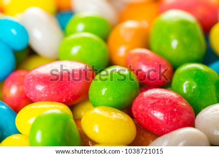 food background of round candy in multicolored glaze