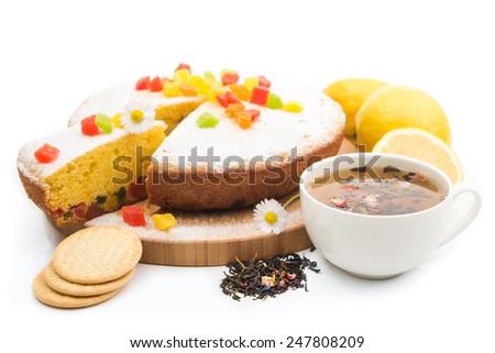 Food background. Pie, lemons with hot tea isolated on white background. - stock photo