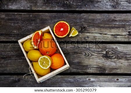 Food background with citrus fresh fruit over rustic wood. Top view. - stock photo