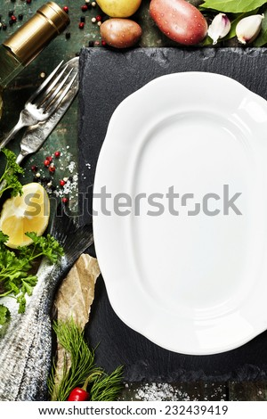 Food background with Fish and Wine. Lots of copy space - stock photo