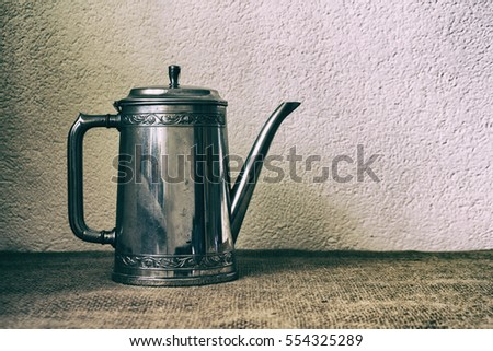 Food background with old antique iron kettle. Vintage food background.  Vintage toning.