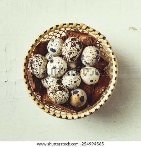 Food background with quail eggs. Top view. Instagram vintage color effect. - stock photo