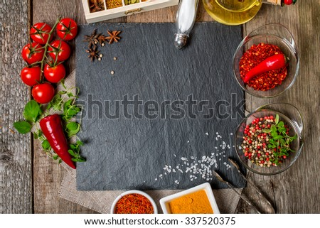 Food background, with space for text, herbs, spices, olive oil, salt, and vegetables. Slate and wood background. Top view - stock photo