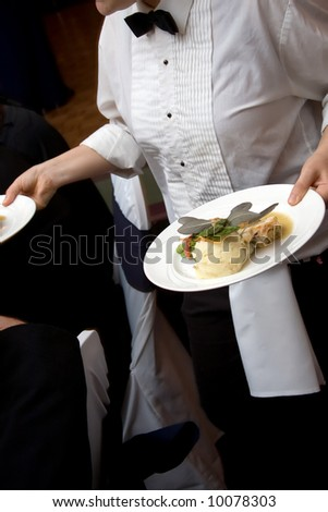 food being served by a waiter during a wedding or catered social event - stock photo