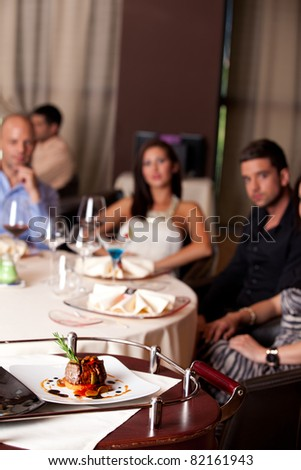 food being served elegant people restaurant table - stock photo