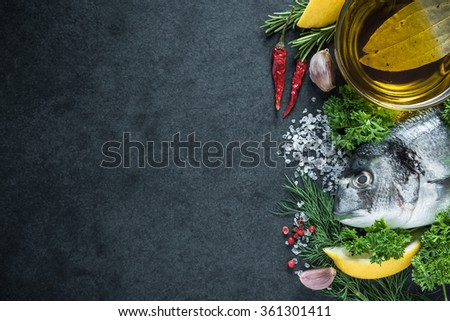 Food border background, sea fish with herbs, overhead - stock photo