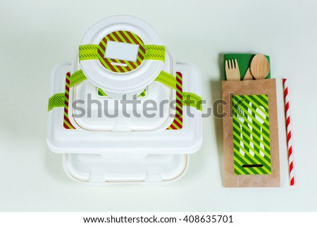 Food boxes and wooden cutlery on white background - stock photo