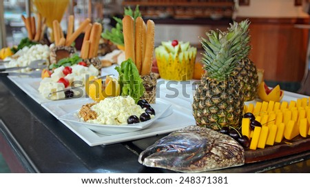 Food Buffet in Restaurant. Buffet Catering Food Arrangement on Table.  People Serving at Buffet. All inclusive. Breakfast buffet. - stock photo