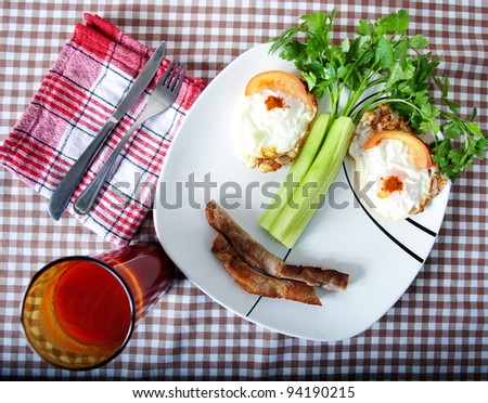 food concept smile; health breakfast with eggs and beacon