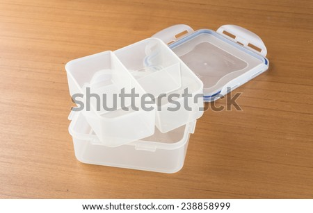 Food containers on wood table - stock photo