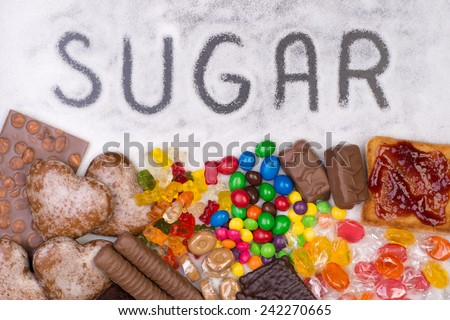 Food containing sugar. Too much sugar in diet causes obesity, diabetes and other health problems - stock photo