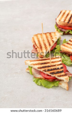 Food. Delicious BLT sandwich on the table - stock photo