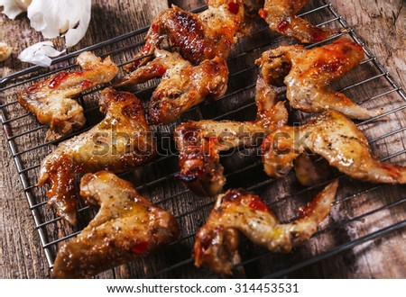 Food. Delicious chicken wings on the table