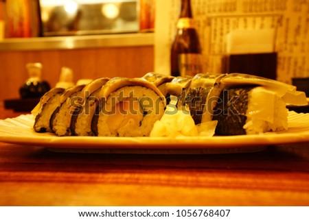 https://thumb7.shutterstock.com/display_pic_with_logo/167494286/1056768407/stock-photo-food-drink-in-izakaya-in-tokyo-1056768407.jpg
