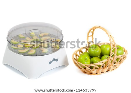 Food dryer and green apples - stock photo