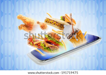Food flying out of a touch screen - stock photo