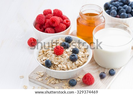 Food for a healthy breakfast on white table, closeup - stock photo
