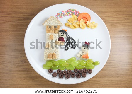 Food for children, prince and princess on the wood background - stock photo