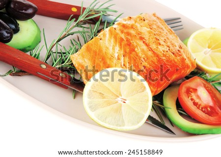 food: grilled salmon on big glass plate isolated on white background - stock photo