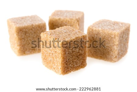 Food: group of four cane sugar cubes, isolated on white background - stock photo