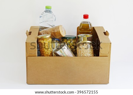 Food in a donation box, isolated in a white background - stock photo