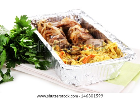 Food in box of foil on napkin  isolated in white
