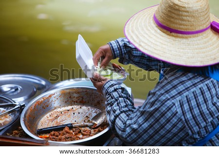 Food in Damnoen Saduak Floating Market near Bangkok, Thailand - stock photo
