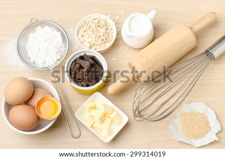 Food ingredient and recipe for backing (cake,dessert,sweet,chocolate),kitchen utensil and tool on wooden background