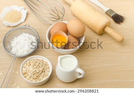 Food ingredient and recipe for backing (cake,dessert,sweet,),kitchen utensil and tool on wooden background - stock photo