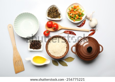 Food ingredients and kitchen utensils for cooking isolated on white - stock photo