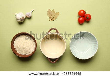 Food ingredients and kitchen utensils for cooking on green background - stock photo