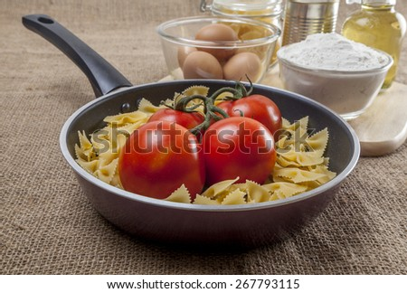 Food ingredients and kitchen utensils for cooking on sackcloth texture background
