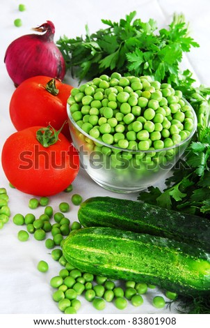 food ingredients, appetizing fresh vegetables, green peas, cucumber and red tomatoes - stock photo