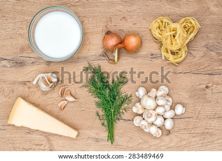 Food ingredients for pasta with mushrooms. - stock photo