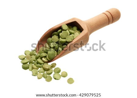 Food ingredients: heap of dried green peas in a wooden scoop, on white background - stock photo