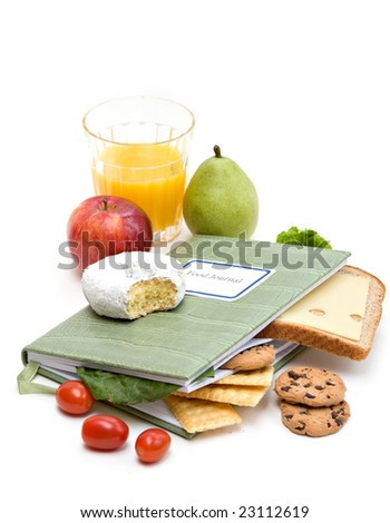 Food Journal or diary surrounded with different foods.  Health and diet concept. - stock photo