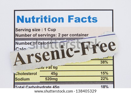 Food label with arsenic free newspaper cutout abstract.
