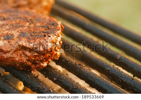 food meat - burgers on bbq barbecue grill Shallow dof. - stock photo