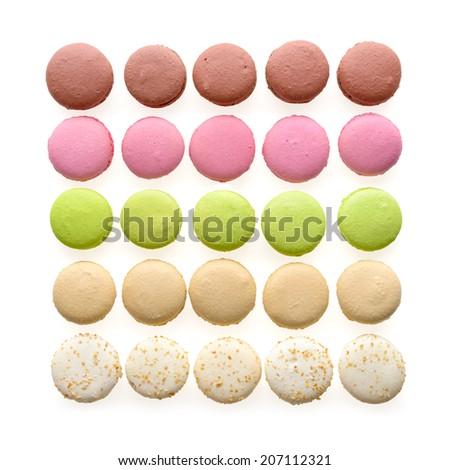 Food: multicolored macarons assortment, arranged in rows, isolated on white background - stock photo