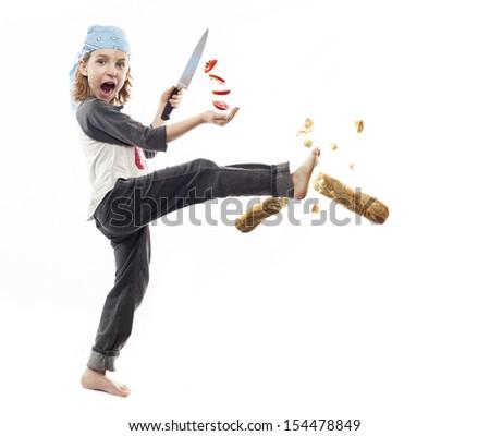 Food ninja chopping Tomatoes - stock photo