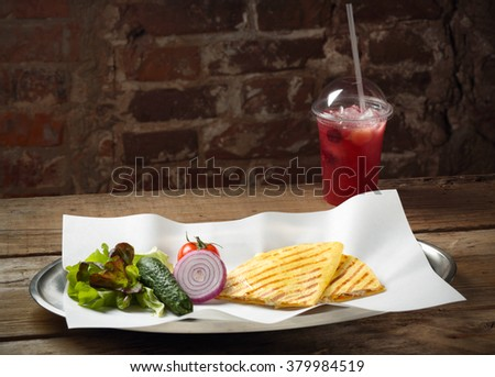 food on a tray with vegetables on background fresh cocktail in a plastic cup - stock photo