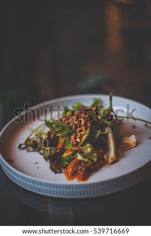Food on glass table, blur in background, vintage film look