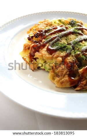 Food on top of a white plate with a sauce drizzled across. - stock photo