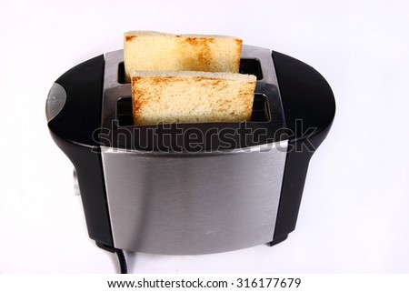 Food photography bread toast in toaster machine - stock photo
