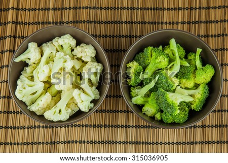 Food preparation on the bowls. The ingredients include fresh green broccolii, and Cauliflower. - stock photo