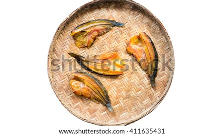 Food Preservation : fish dry out on basket weave : isolated on white background - stock photo