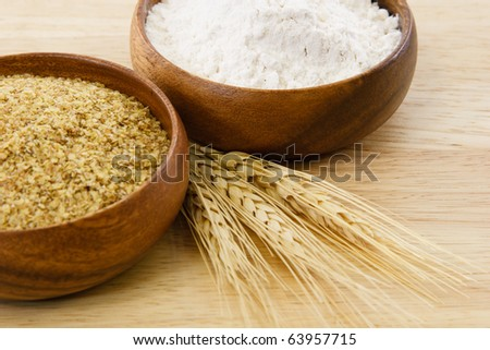 Food processed from wheat illustrate tasty ingredients and food allergens.  Image includes copy space. - stock photo