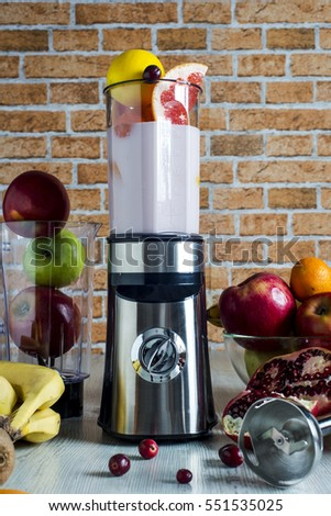 food processor and blender on the kitchen table for the juice of various fruits.